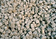 A pile of loose granite setts