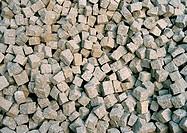 A pile of loose granite setts