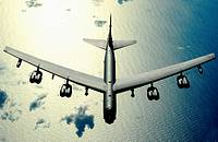 A B-52 Stratofortress from Minot Air Force Base, N D  flies over the Pacific Ocean on Nov  12, 2008  The B-52 is deployed to Andersen A F B  Guam, 23r...