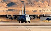 A formation of C-130 Hercules taxis in after a training mission during the U S  Air Force Weapons School's Mobility Air Forces Exercise MAFEX at Nelli...