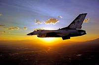A lone F-16 Fighting Falcon from the U  S  Air Force Thunderbirds flies against the sunrise  The demonstration squadron has recently released its 2009...