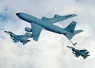 A KC-135 from the 100th Air Refueling Wing, RAF Mildenhall, England, refuels a pair of F-16 Fighting Falcons from Spangdahlem Air Base, Germany, durin...
