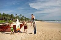 Surfers in Hikkaduwa, Sri Lanka