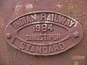 A nameplate indicating manufacturing year and place is fixed on frontside of a freight car, Mhow, Madhyapradesh, India