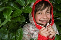 A young girl hiding in a bush