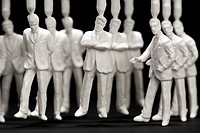 A medium group of plastic businessmen figurines