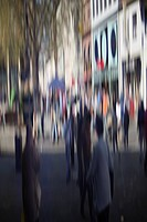 Defocused street scene with people walking
