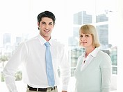 Businessman and businesswoman standing in office