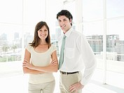Businesswoman and businessman standing in office