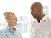 Businesswoman and businessman having discussion