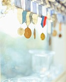 Medals hanging in a window.