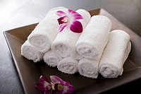 Rolled towels and orchid flowers