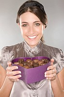 Woman holding a box of chocolates (thumbnail)
