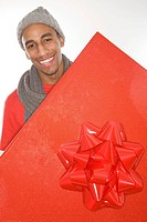 Man holding a large red gift