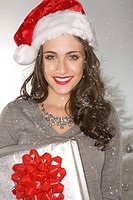 Smiling woman wearing a santa hat