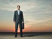 Businessman standing in the desert