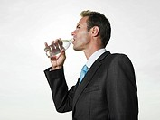 Businessman drinking bottled water
