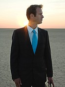 Businessman at sunset in the desert