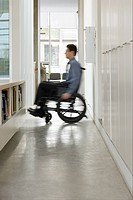 Blurred man in a wheelchair