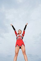Cheerleader with arms raised
