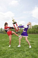 Cheerleaders fighting over trophy
