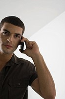Young man on cellphone (thumbnail)