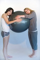Two young women exercising together