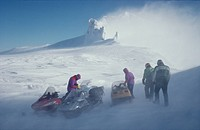 People with snowmobile on snow_covered area