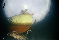 Man fishing on boat underwater view