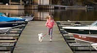 Woman running on the pier, Lake of the Woods, Ontario, Canada