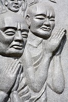 Long Son Pagoda, Nha Trang City, Vietnam, Asia, Relief of praying people