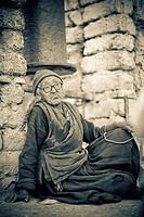 Lamayuru Monastery, Ladakh, India, Local woman sitting outside monastery