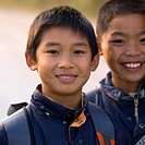 Two young boys outdoors in China