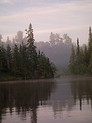 Lake of the Woods, Ontario, Canada, Mist rises over lake