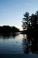 Lake of the Woods, Ontario, Canada, Sunset over placid lake