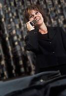 Businesswoman having fun phone conversation