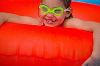 Portrait of little girl playing in Swimming Pool