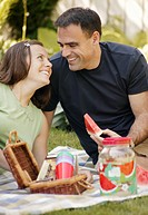 Adult couple having a picnic