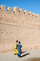 Morocco, Essaouira  People walking at the foot of the city walls