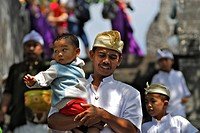 Pilgrims with children at Temple Pura Luhur Uluwatu, South Bali, Indonesia, Asia