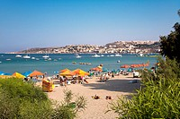 People at the beach in the sunlight, Mellieha Bay, Malta, Europe