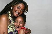 Portrait of African American mother and daughter, studio shot