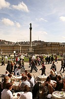 People in a sidewalk cafe, view at the New Castle with Jubilaeumssaeule, Palace Square, Stuttgart, Baden_Wurttemberg, Germany