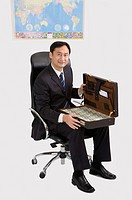 Businessman holding a suitcase with paper money, Business People