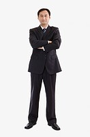 Businessman standing with hands on chest, Business People