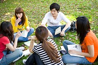 Five college students studying on the lawn together, Studying, Education