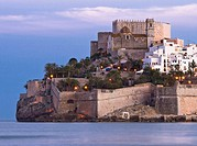 Sunset in the Mediterranean Sea and the Castillo del Papa Luna at the top of the town of Peniscola - Baix Maestrat - Castellon - Valencia