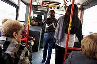 Florida, Miami Beach, South Beach Local Metrobus, bus, public transportation, seat, woman, women, aisle, sitting, riding, standing, stop, passengers,
