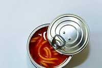 Opened can of spaghetti in tomato sauce