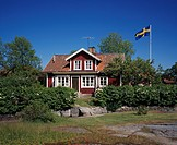 Rural house with Swedish flag